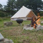 Firepit and barbeque outside Cashel Bell tent